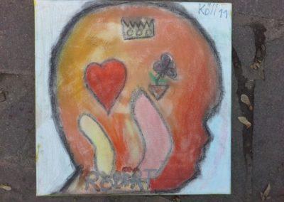"""120 Robert sagt: """"Ich habe warme und gute Gefühle. Für die Liebe habe ich ein Herz gemalt. Die Blume steht für Freude und die Krone für Glück."""""""